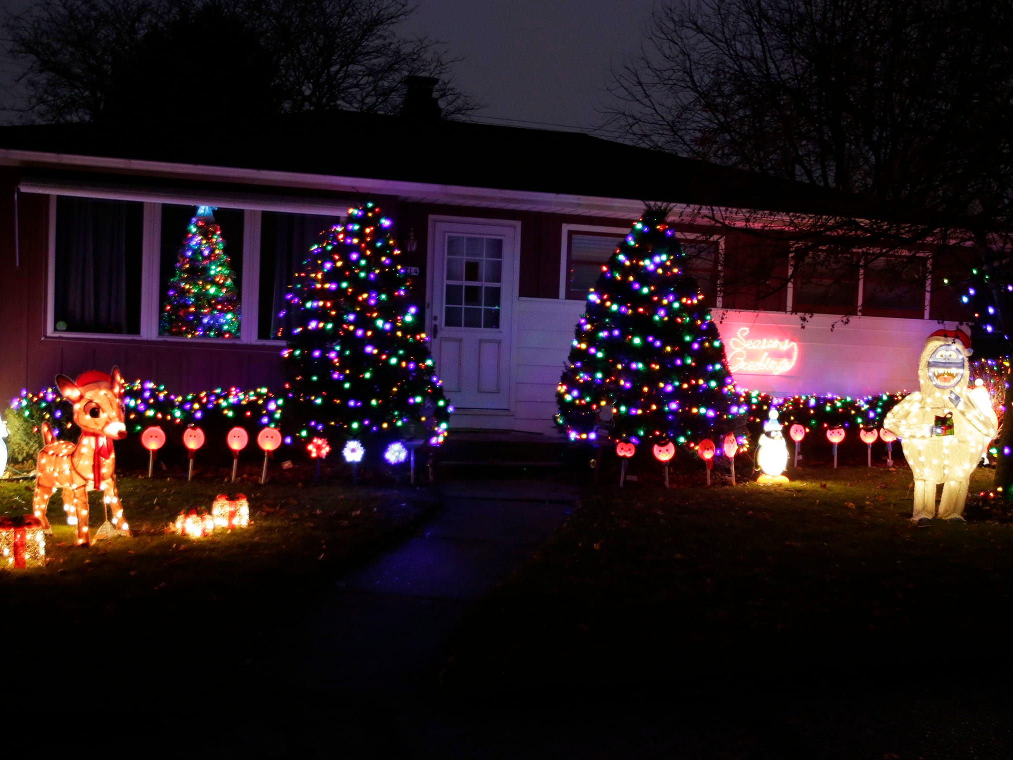 A south side home is decorated for the holidays, Wednesday, December 12, 2018, in Sheboygan, Wis.