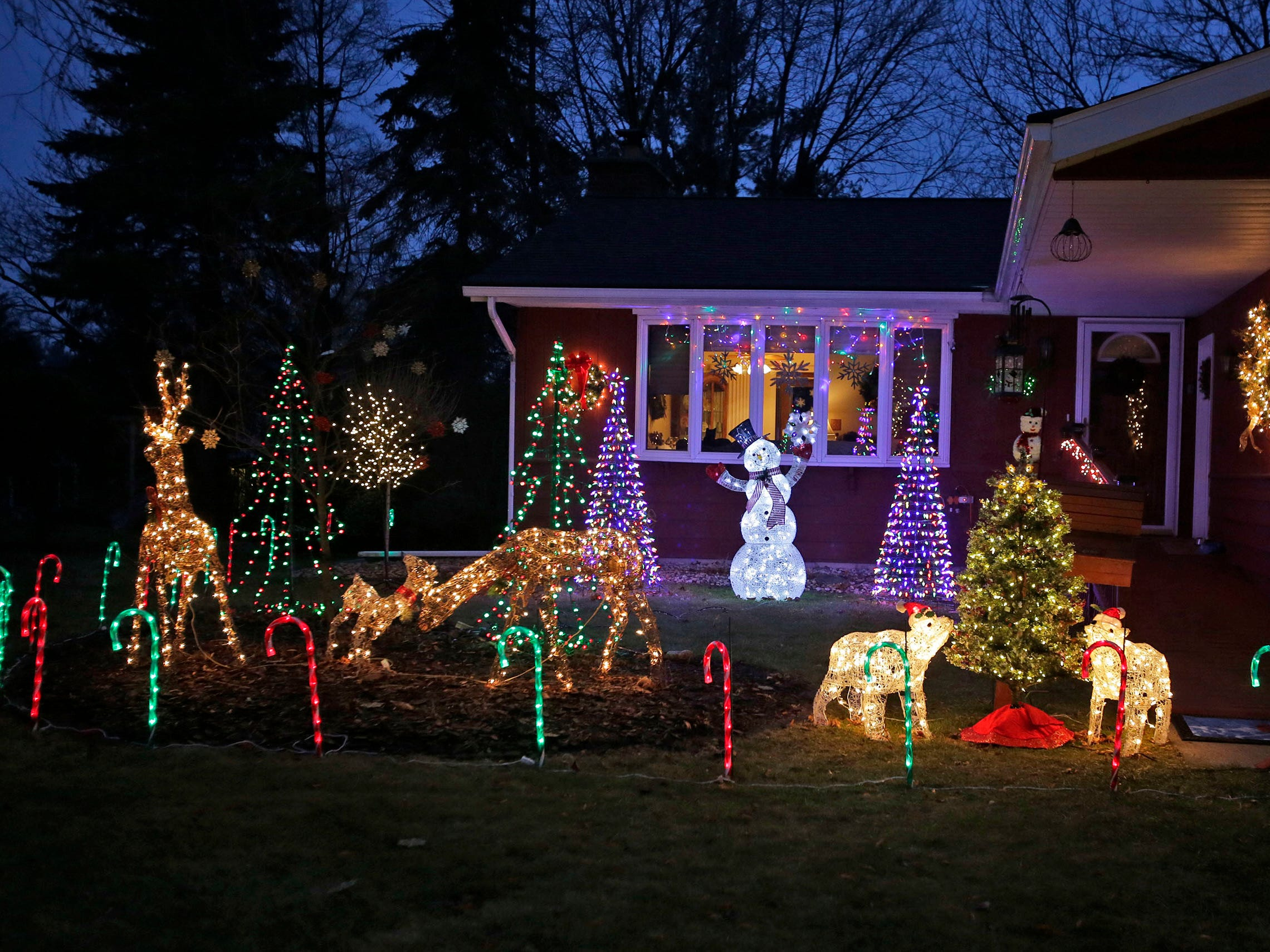 A home at 17th and Kaumann has plenty of bright holiday lights as seen, Wednesday, December 12, 2018, in Sheboygan, Wis.