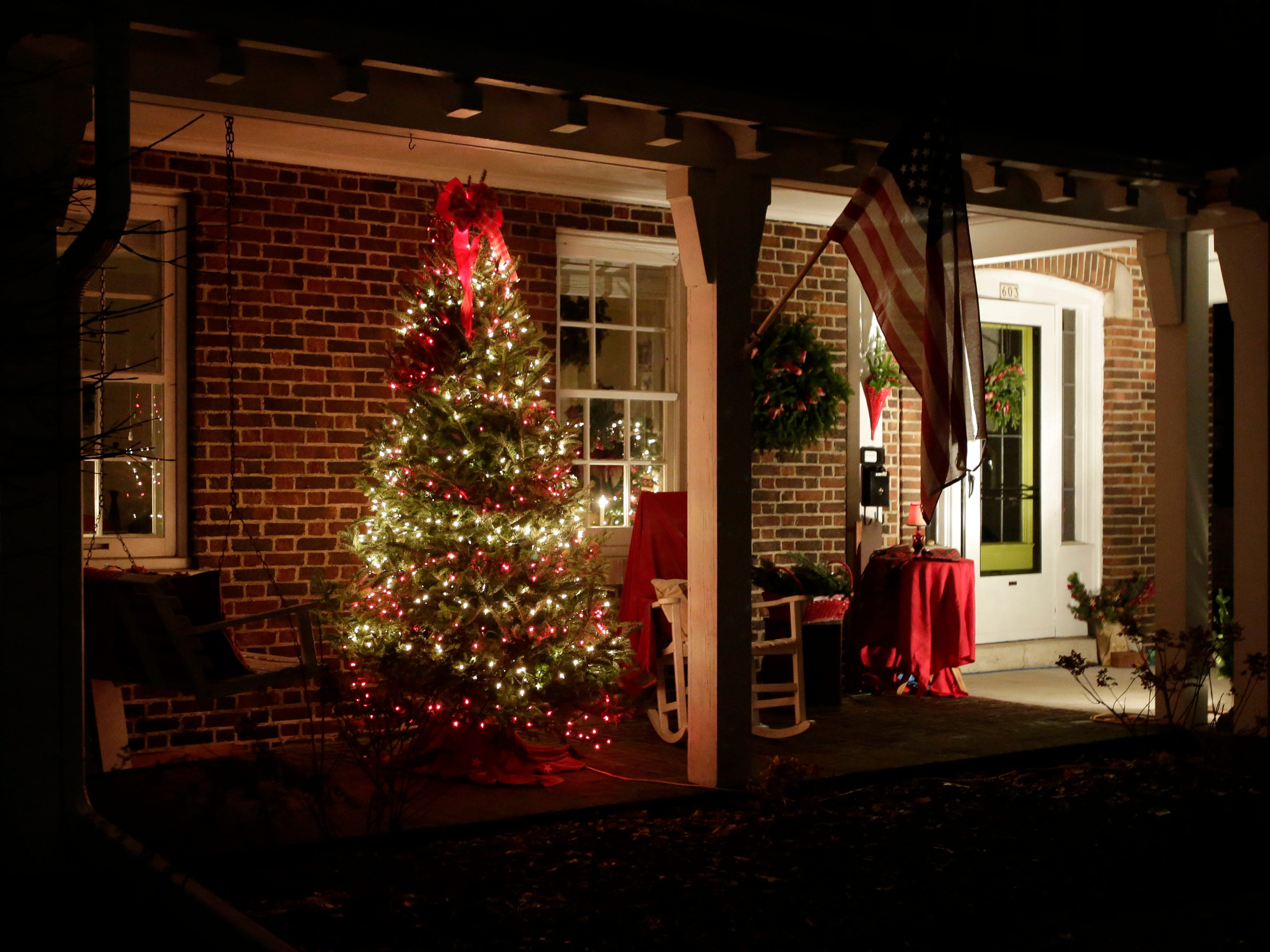 A home near 6th and Superior features a decorated tree, Wednesday, December 12, 2018, in Sheboygan, Wis.