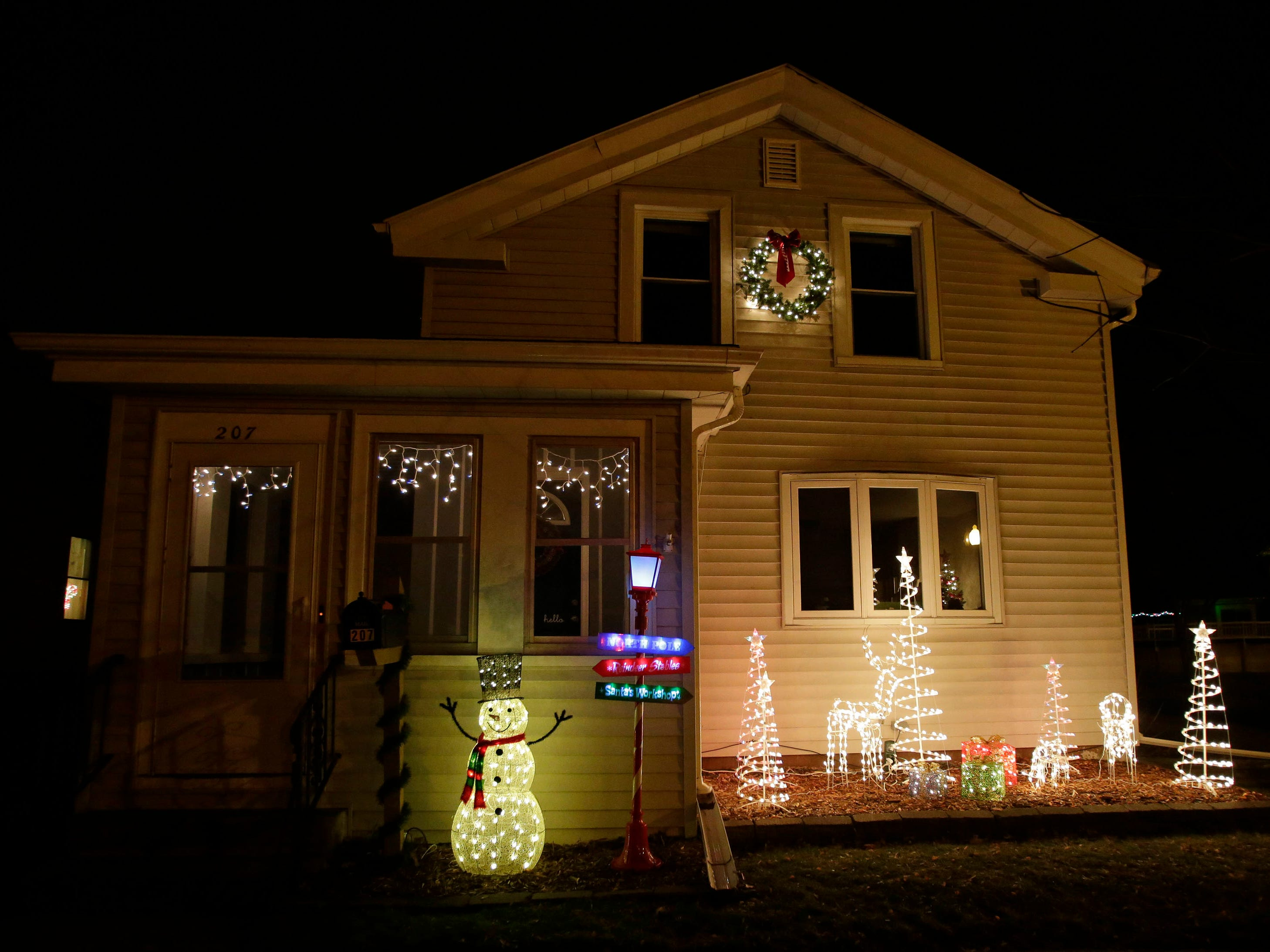 A home on Buffalo St. is decorated for the holidays, Wednesday, December 12, 2018, in Sheboygan Falls, Wis.