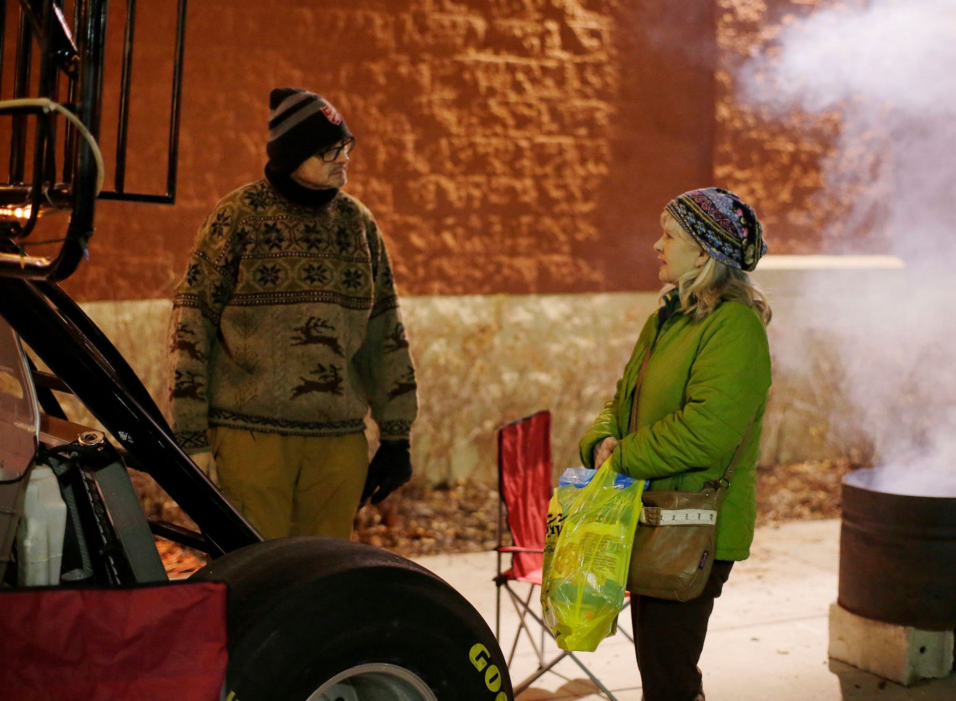 Salvation Army's Captain Daryl Mangeri, left, talks about the plight of the homeless with Kathy Powers of Sheboygan, while outside Festival Foods, Wednesday, December 12, 2018, in Sheboygan, Wis. Mangeri is sleeping in a tent outside of the store for five nights to put a light on the fact that homeless people live among us. He said that the more fortunate should step up and use their time, talent and money to help people in this situation.