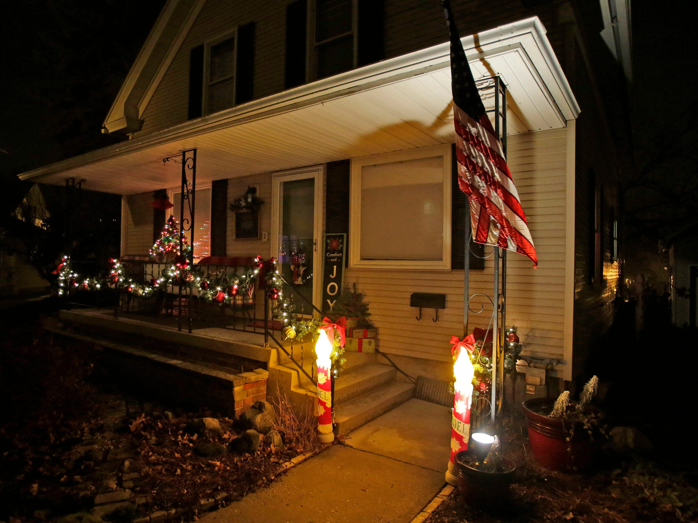 A home features Noel candles Wednesday, December 12, 2018, in Sheboygan Falls, Wis.