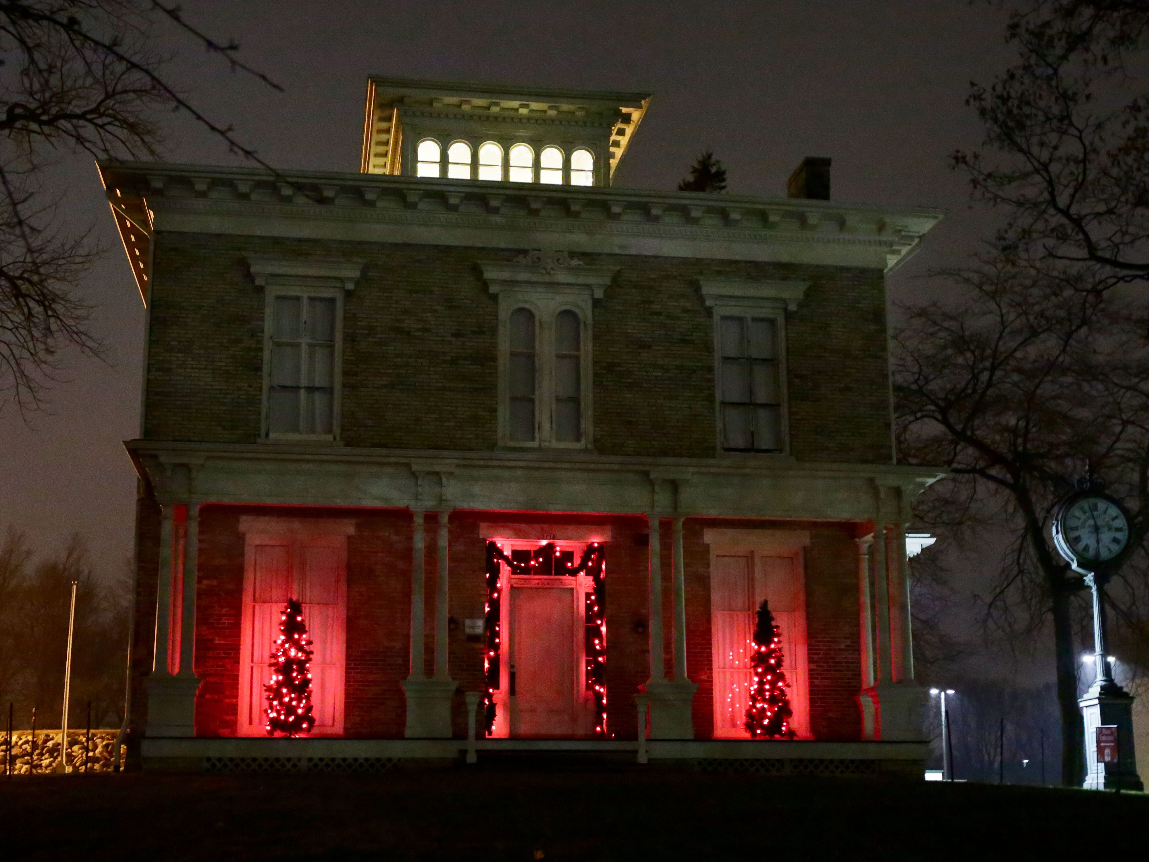 The David Taylor House on the grounds of the Sheboygan County Historical Museum is aglow with color, Wednesday, December 12, 2018, in Sheboygan, Wis.