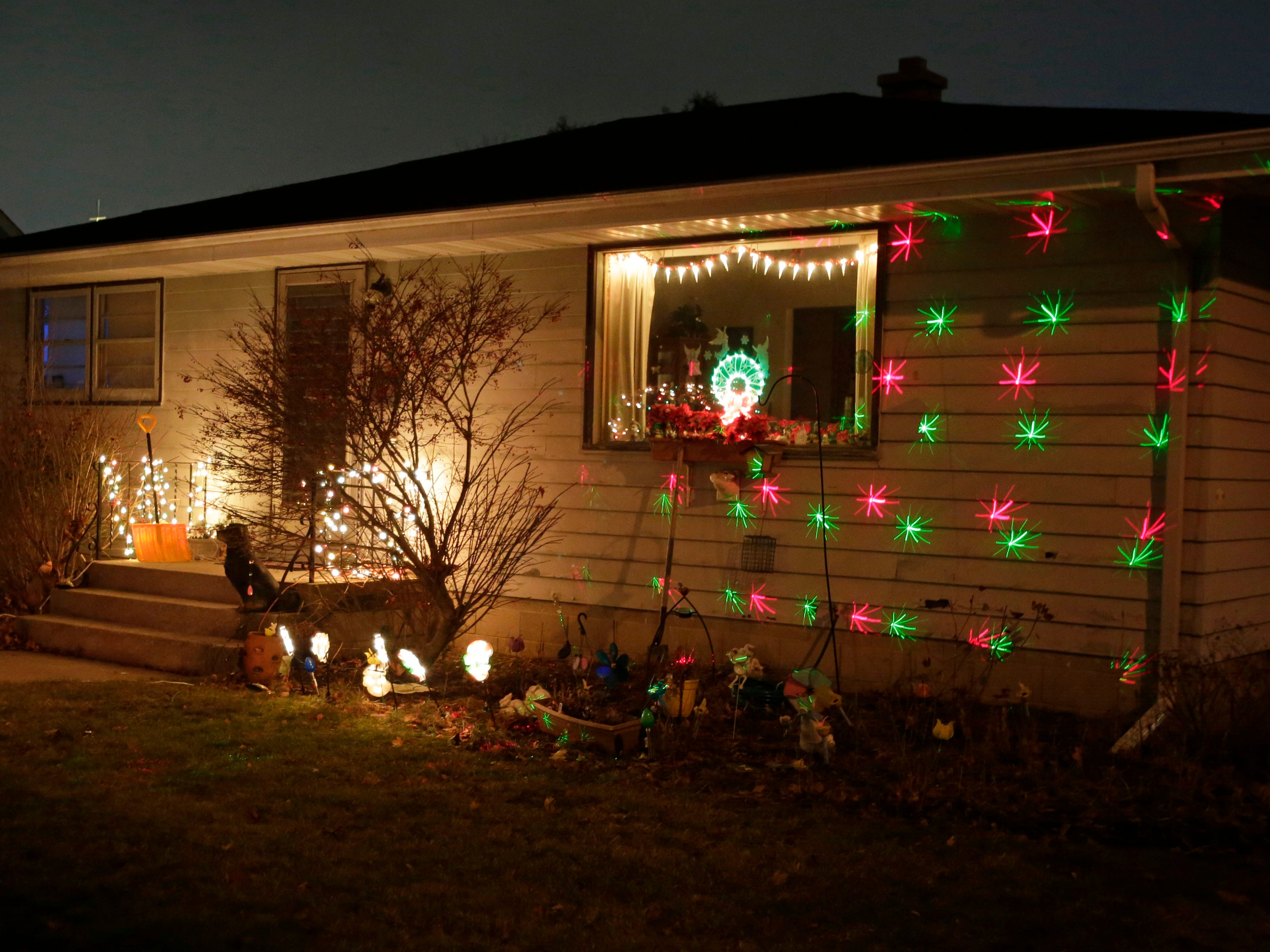 A home on Ontario Avenue features a snowflake type projection, Wednesday, December 12, 2018, in Sheboygan, Wis.