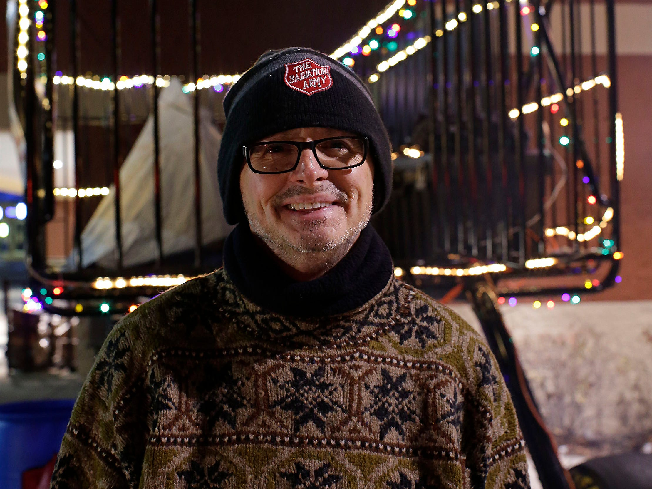 "Salvation Army Captain Daryl Mangeri poses by the giant shopping cart that holds the tent he will sleep in for five nights in the cold outside of Festival Foods, Wednesday, December 12, 2018, in Sheboygan, Wis. Freezing for a reason is a way that Mangeri says that he hopes lets the public know that there are homeless who live among us.  ""If we are blessed with resources of time, talent and money, we should help them."