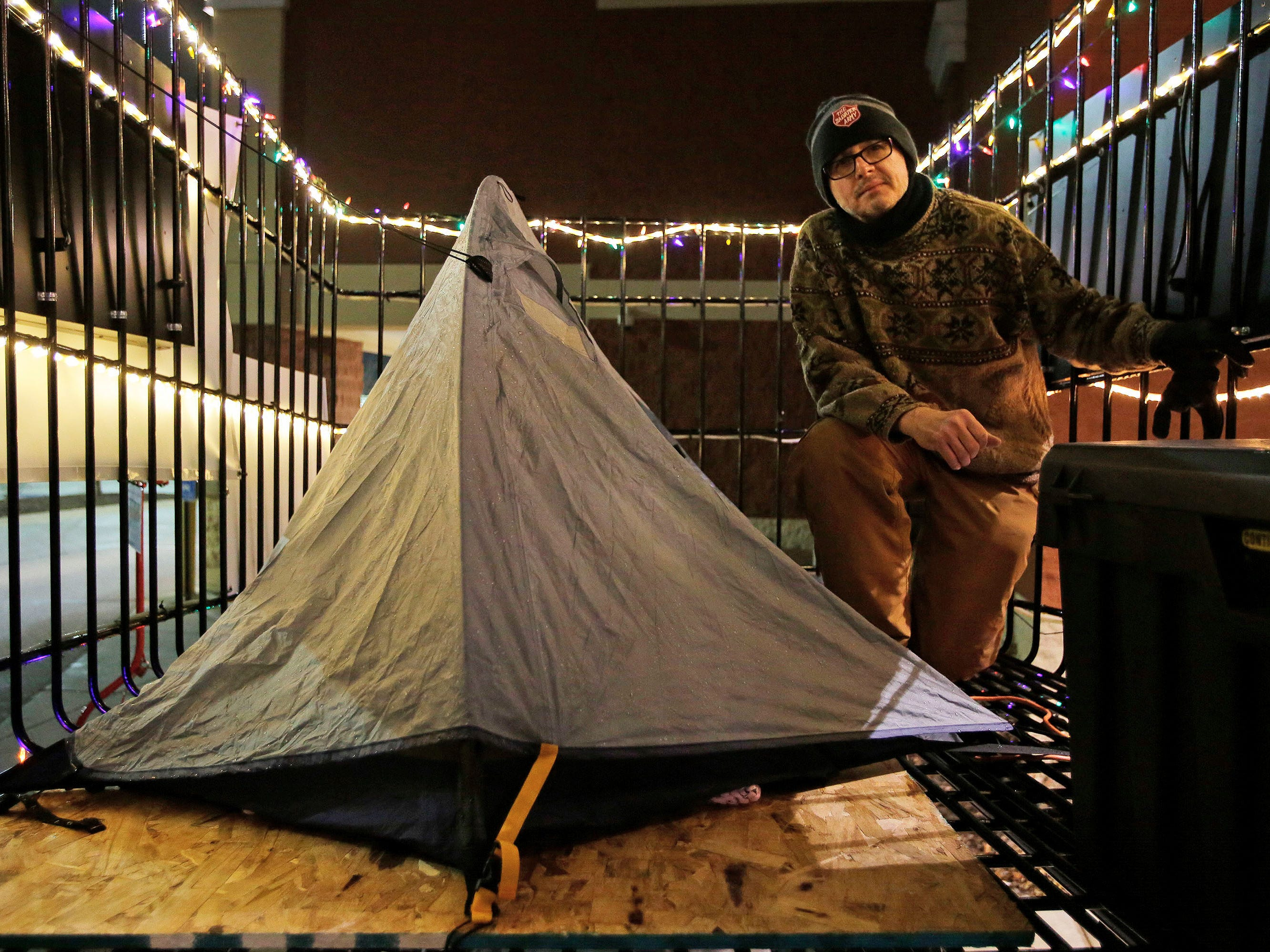 "Salvation Army Captain Daryl Mangeri poses by the tent he will sleep in for five nights in the cold, Wednesday, December 12, 2018, in Sheboygan, Wis. Freezing for a reason is a way that Mangeri says that he hopes lets the public know that there are homeless who live among us.  ""If we are blessed with resources of time, talent and money, we should help them."