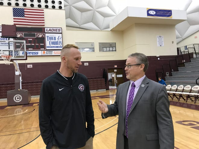 Northwestern athletic director Greg Burke makes a point during a visit with Centenary women's coach Jason Schmitz Thursday afternoon at the Gold Dome.
