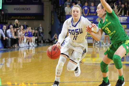 SDSU's Madison Guebert (11) drives to the bucket past Oregon's Taylor Chavez during the second quarter of the matchup against the Ducks Wednesday night at Frost Arena in Brookings.