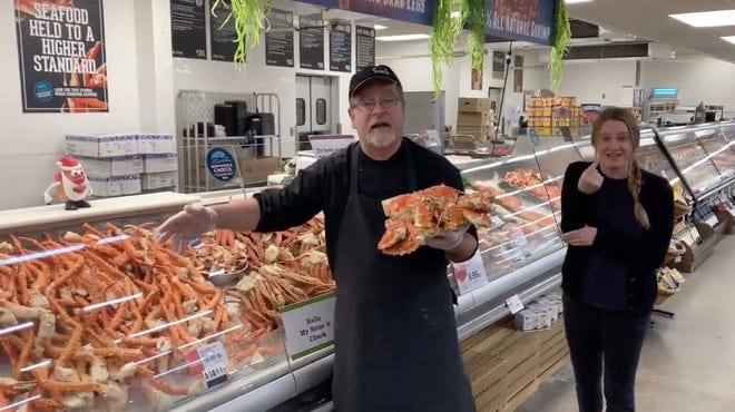 Jeff Rud, seafood manager at the Hy-Vee grocery store on South Marion Road in Sioux Falls, and his daughter-in-law Kayla, a sign language interpreter, are shown in this screenshot of the store's seafood online promo video.
