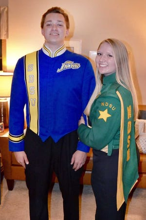 Maret Otterson and Paul Otterson played in their high school marching band together for three years. Now, the siblings are rooting for separate teams as SDSU and NDSU battle in the FCS Football Semifinals.