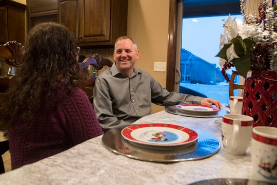 Bryan Theodore Nelson, 48, speaks to his wife Kandie Nelson, 45, at their dinner table in Sioux Falls, S.D., Wednesday, Dec. 12, 2018.