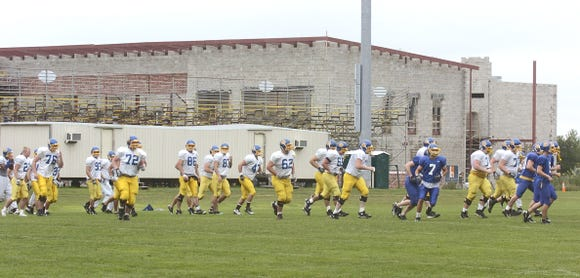 The Jacks head to their practice field in 2009 with trailers used as offices and the Dykhouse Center under construction in the background.