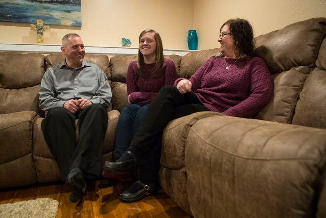 Bryan Theodore Nelson (left to right), Kayla Nelson and Kandie Nelson interact with each other at their house in Sioux Falls, S.D., Wednesday, Dec. 12, 2018. Kayla and Kandie both have a rare (1 in 500) medical condition called Cerebral Cavernous Malformation (CCM), which is where there are tangles of blood vessels in the brain or spinal