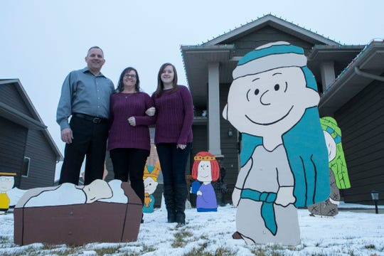 Bryan Theodore Nelson (left to right), Kandie Nelson and Kayla Nelson pose outside of their house in Sioux Falls, S.D., Wednesday, Dec. 12, 2018. Kayla and Kandie both have a rare (1 in 500) medical condition called Cerebral Cavernous Malformation (CCM), which is where there are tangles of blood vessels in the brain or spinal cord that will bleed and can cause hemorrhages, seizures, or stroke-like symptoms.