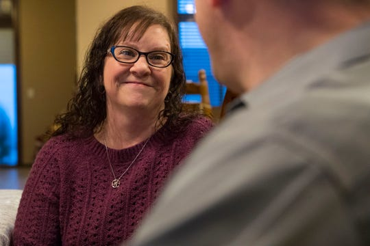 Kandie Nelson, 45, speaks to her husband Bryan Theodore Nelson, 48, at their dinner table in Sioux Falls, S.D., Wednesday, Dec. 12, 2018. Kandie has a rare (1 in 500) medical condition called Cerebral Cavernous Malformation (CCM), which is where there are tangles of blood vessels in the brain or spinal cord that will bleed and can cause hemorrhages, seizures, or stroke-like symptoms.