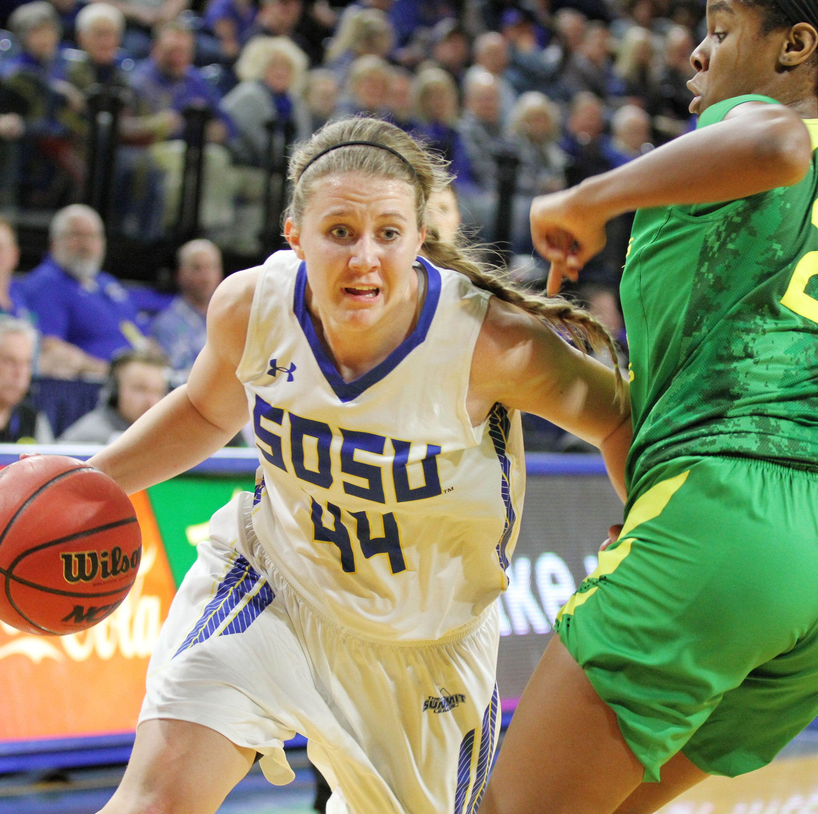 SDSU's Myah Selland (44) drives spast Oregon's Ruthy Hebard during the second quarter of the matchup against the Ducks Wednesday night at Frost Arena in Brookings.