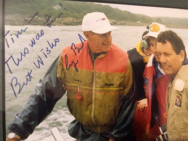 On a boat with Johnny Morris and President Bush