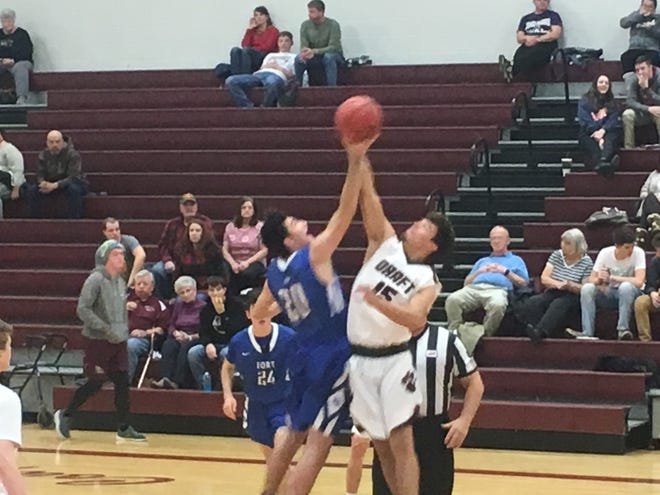 Fort's Devon Simonetti and Draft's Kasey Branch go up for the opening tip.