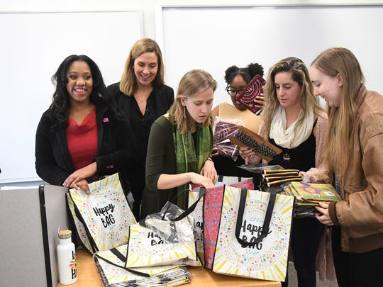 Mary Clay Thomas (second from left), associate professor and director of social work at Mary Baldwin University, works with student interns participating in the See The Girl program, at the university on Dec. 5, 2018. They sort through items they plan to give to the female students they work with in Staunton elementary schools. With her from left are: senior Makela McRae, junior Jessica Ross, senior Jazzlyn Manning, senior Brianna Shears and senior Sarah Lawson.
