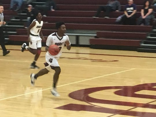 Stuarts Draft's Jo'-el Howard brings the ball up the court for the Cougars.