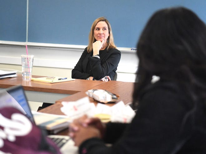 Mary Clay Thomas, associate professor and director of social work at Mary Baldwin University, listens as student interns, participants in the See The Girl program, talk about  interactions with the female students they are paired with in Staunton elementary schools. They gather together during a weekly seminar session at the university on Dec. 5, 2018.