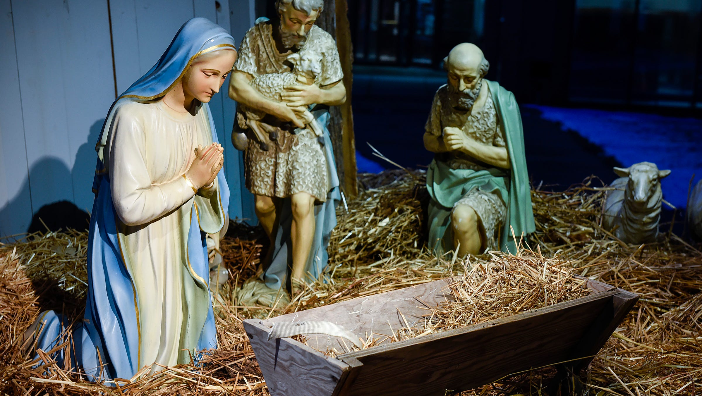The baby Jesus figure is missing from the antique nativity scene at the U.S. Bank shown Thursday, Dec. 13, in St. Cloud.
