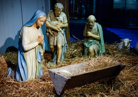 The baby Jesus figure was missing from the antique nativity scene at the U.S. Bank shown Thursday, Dec. 13, 2018, in St. Cloud.