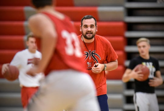 ROCORI head basketball coach Levi Peterson runs a drill during practice Wednesday, Dec. 12, in Cold Spring.