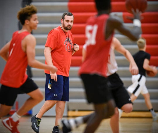 ROCORI head basketball coach Levi Peterson watches close as his players run plays during practice Wednesday, Dec. 12, in Cold Spring.