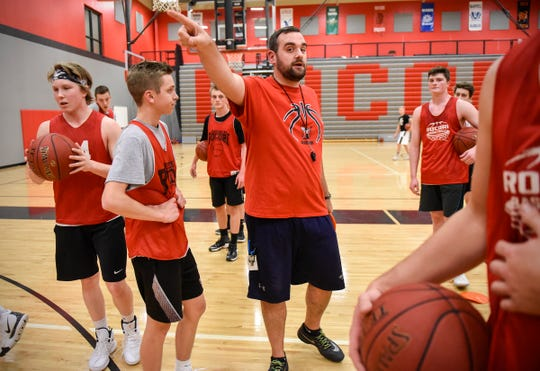 ROCORI head basketball coach Levi Peterson sets up the next drill for players during practice Wednesday, Dec. 12, in Cold Spring.