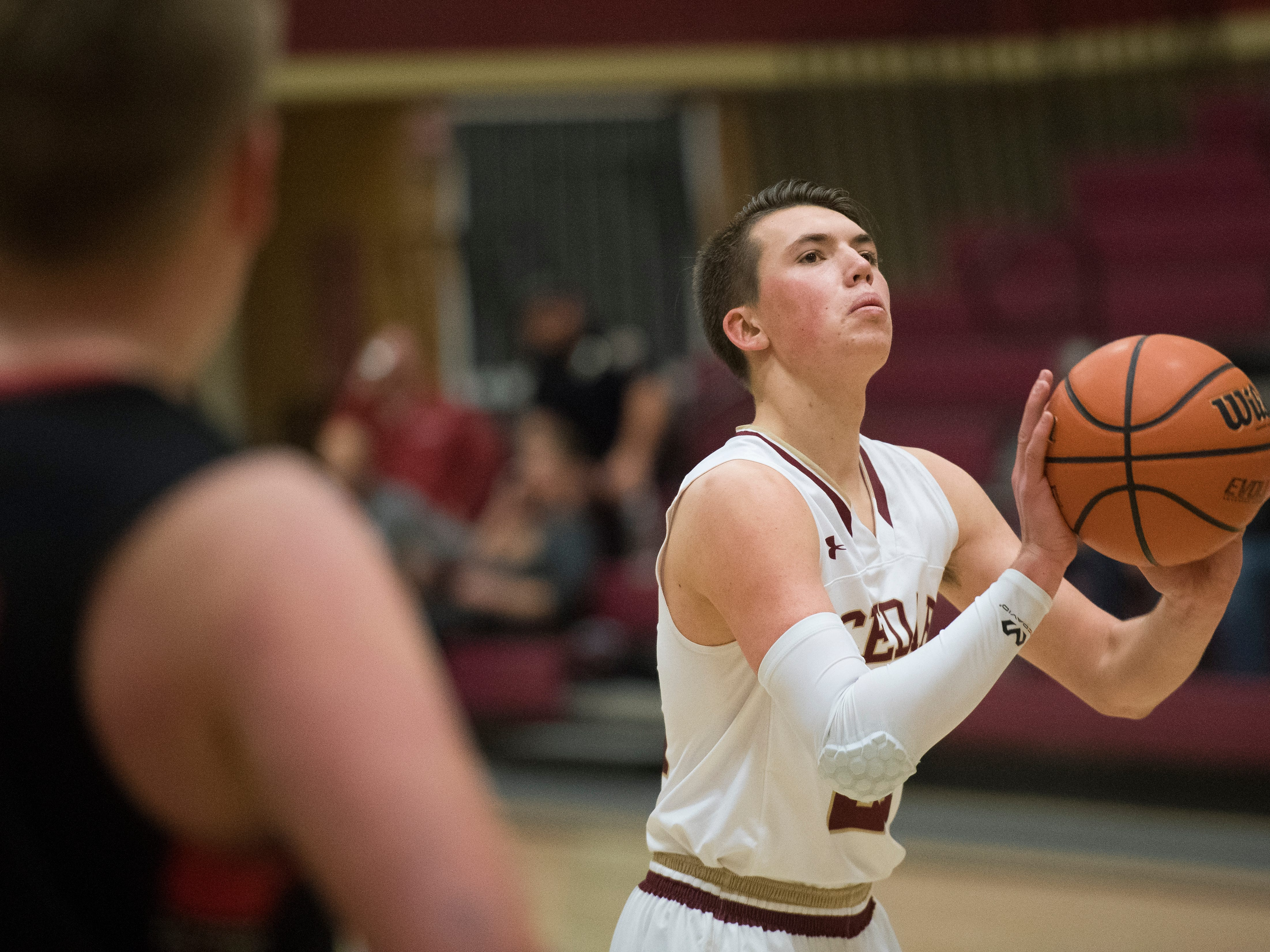 Cedar High School senior Tanner Eyre (21) makes a free-throw against Lincoln County at CHS Wednesday, December 12, 2018. The Redmen won, 80-54.