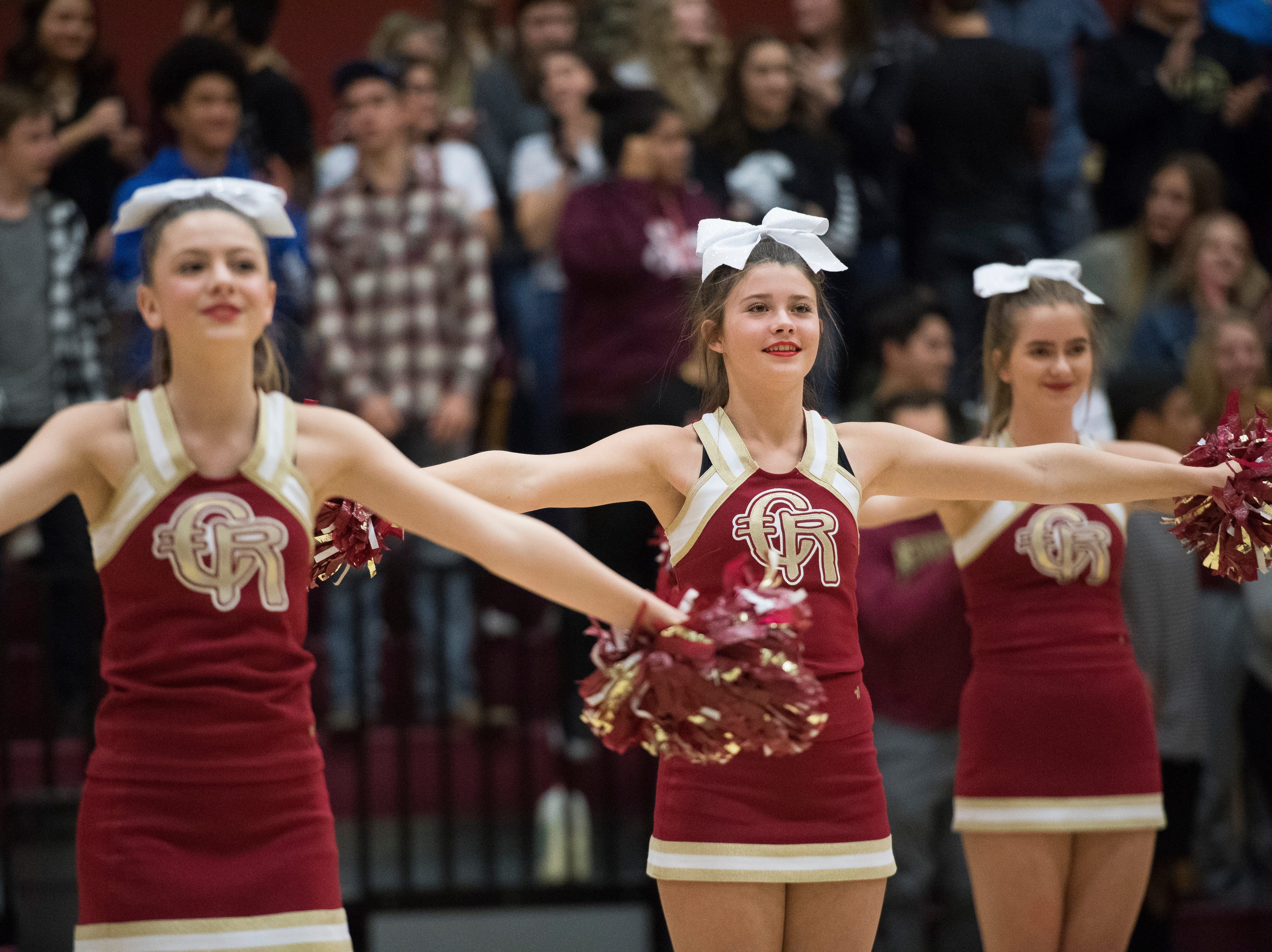 Cedar High School cheerleaders perform during halftime of the game against Lincoln County at CHS Wednesday, December 12, 2018. The Redmen won, 80-54.
