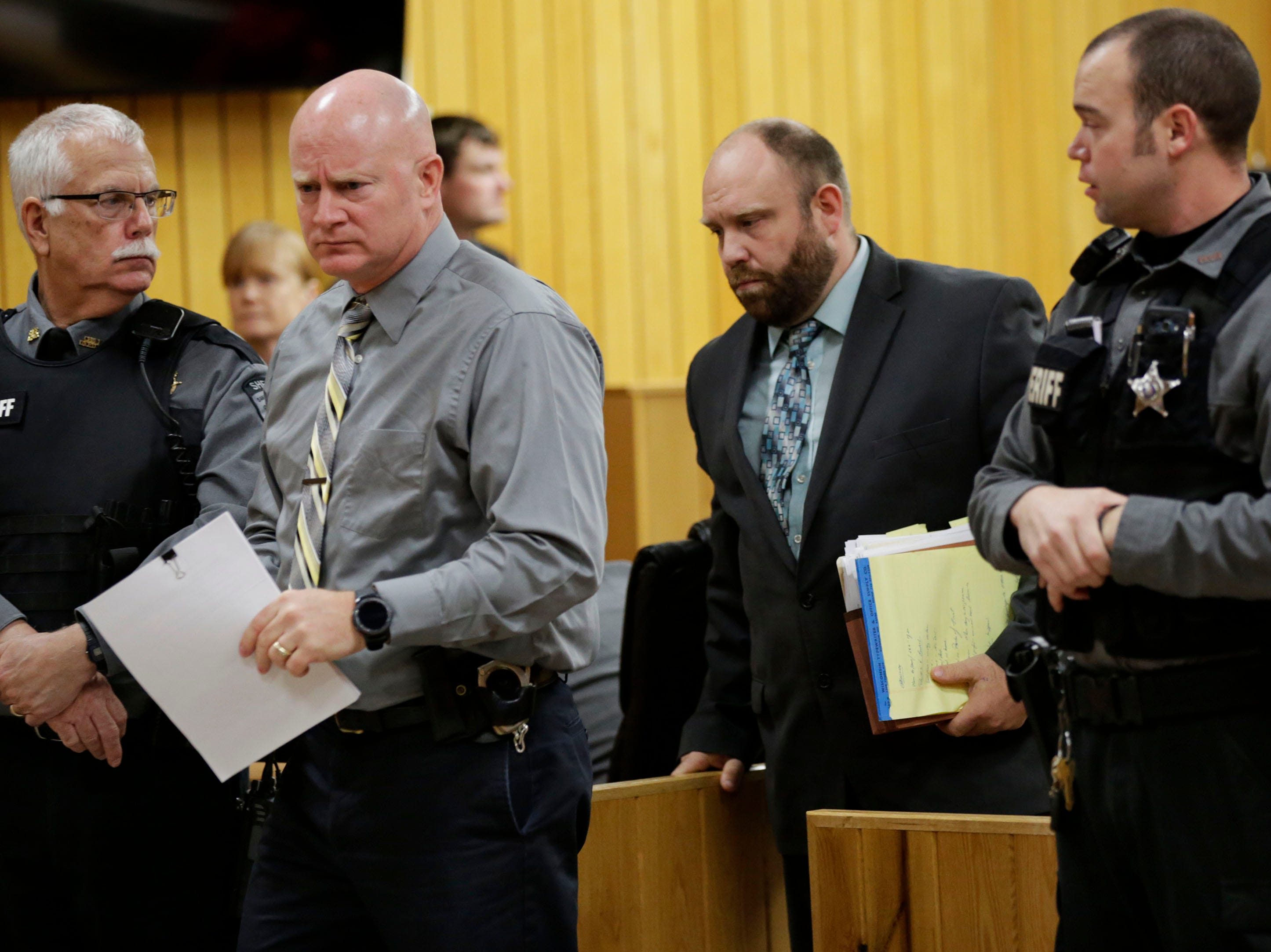 Sawyer County Sheriff's Detective Brian Deyo and Sawyer County Assistant District Attorney Aaron Marcoux leave the courtroom after a preliminary hearing in the case of former Catholic priest Thomas Ericksen on Wednesday, December 12, 2018, at the Sawyer County courthouse in Hayward, Wis.Tork Mason/USA Today NETWORK-Wisconsin