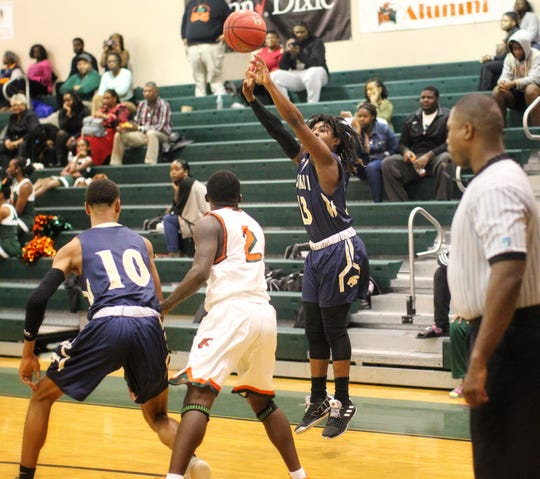St. John Paul II junior guard Tyreke McElwain shoots a 3-pointer as the Panthers pulled out a district win at FAMU DRS on Dec. 4, 2018.