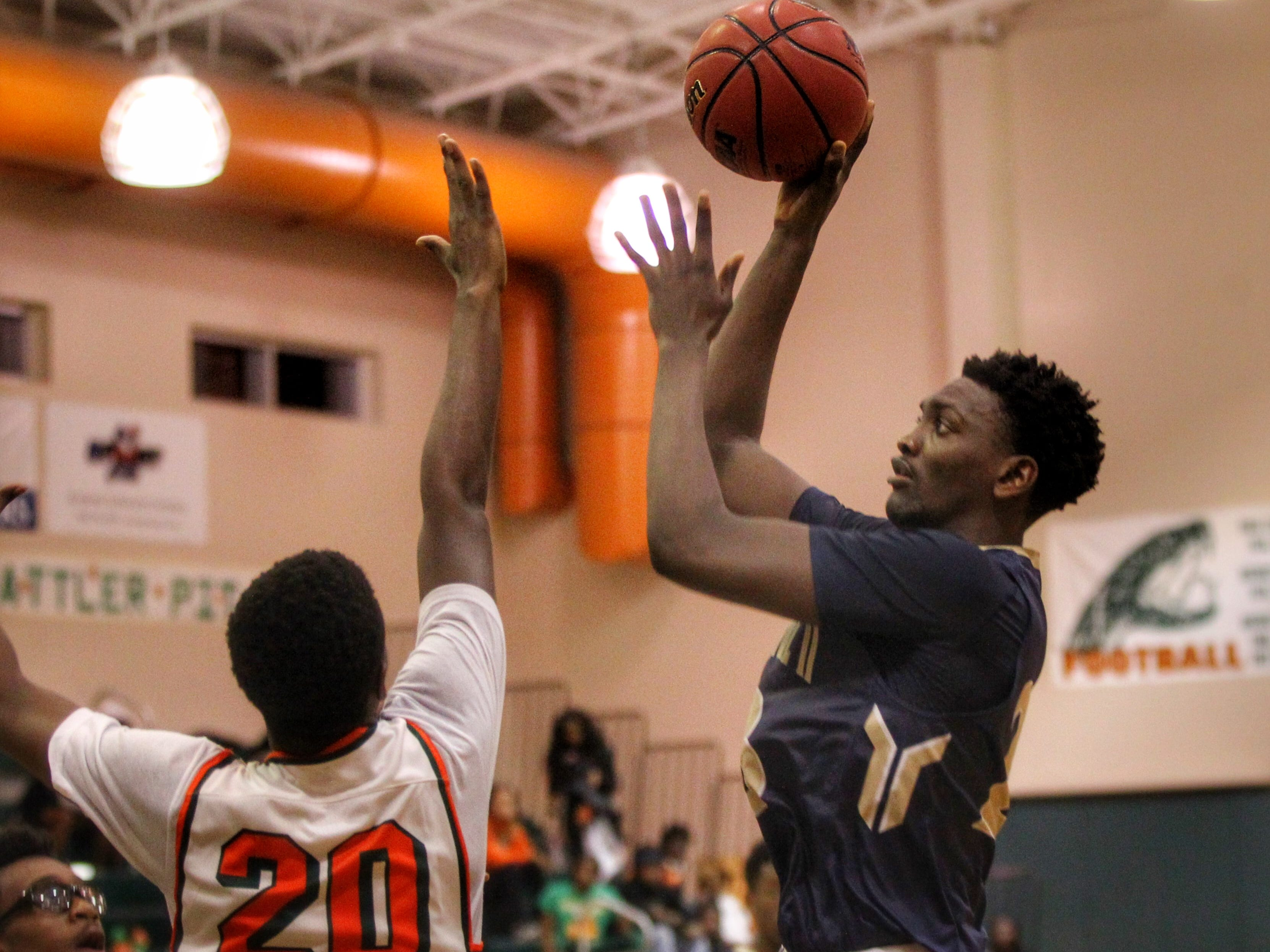 St. John Paul II senior forward Chosen Levarity goes up for a baby hook as the Panthers pulled out a district win at FAMU DRS on Dec. 4, 2018.