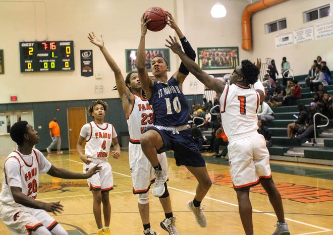 St. John Paul II senior guard Allan Jeanne-Rose drives to the basket as the Panthers pulled out a district win at FAMU DRS on Dec. 4, 2018.