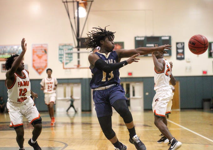 St. John Paul II junior Tyreke McElwain drives and kicks as the Panthers pulled out a district win at FAMU DRS on Dec. 4, 2018.
