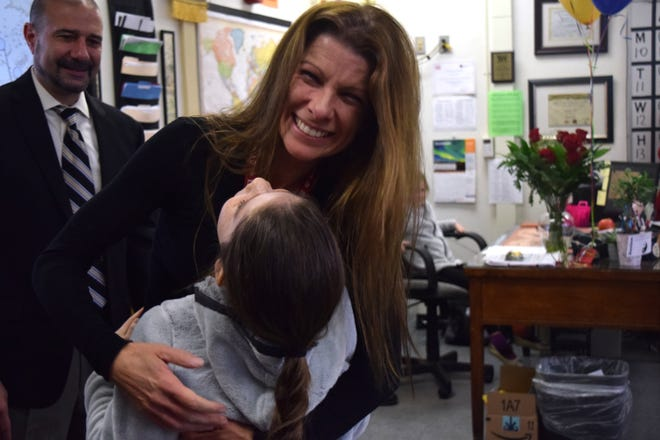 Leon County Schools 2018-19 Teacher of the Year Jeannine Meis hugs her daughter after she was surprised with the award Thursday morning. Meis is a teacher at Leon High School.