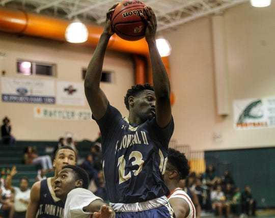 St. John Paul II senior forward Chosen Levarity hauls in a rebound as the Panthers pulled out a district win at FAMU DRS on Dec. 4, 2018.