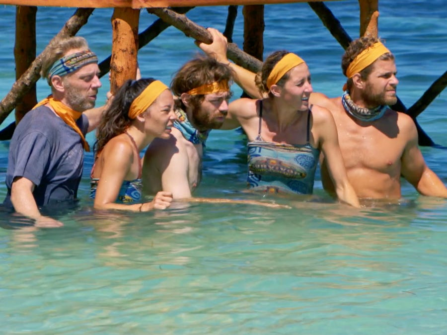 """Survivor"" episode 10:  Christian Hubicki, center, and others compete in a challenge."