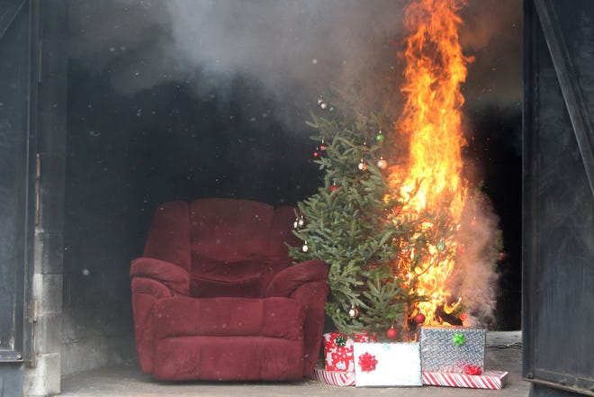A Christmas tree catches fire in this Dec. 13 demonstration presented by the Tallahassee (Fla.) Fire Department. Live trees should be watered and placed at least three feet from all combustibles.