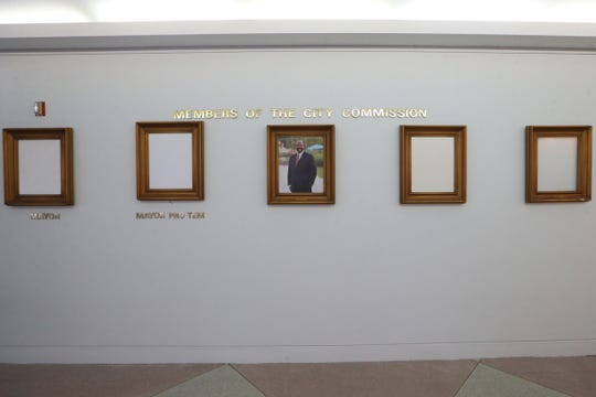 City Commissioner Curtis Richardson's portrait hangs on the second floor wall of City Hall after Scott Maddox's portrait was removed due to his indictments, Thursday, Dec. 13, 2018. The other three frames are awaiting portraits of the new mayor and commissioners, six weeks after the 2018 elections.