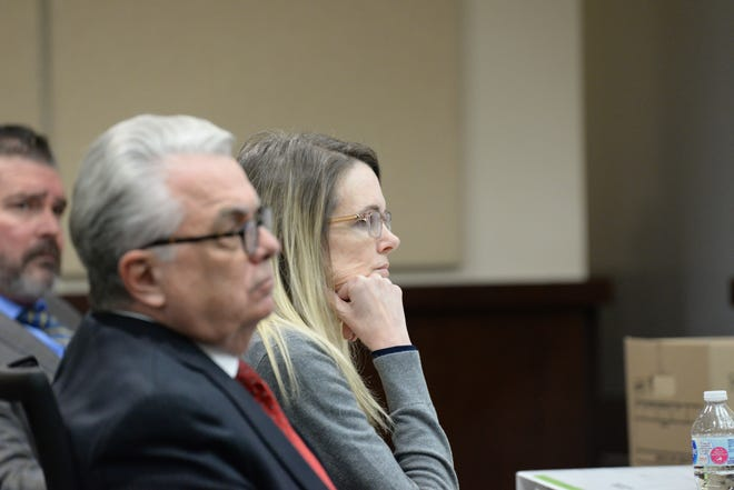 Denise Williams sits with her attorney Philip Padovano during her murder trial last week. She will be sentenced in February.