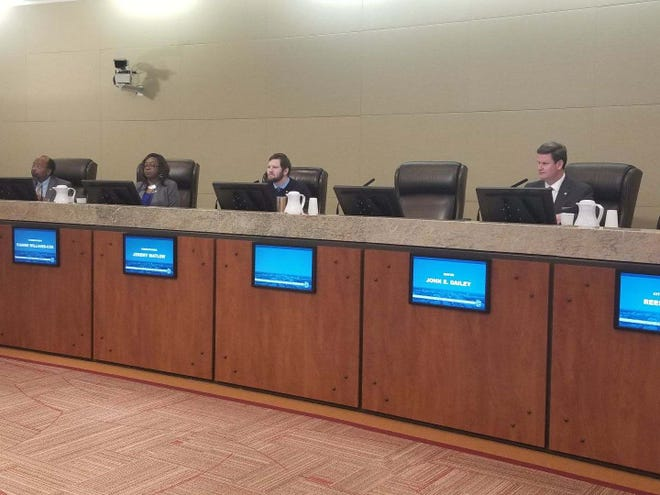 City Commissioner Scott Maddox's chair sits was noticeably empty at Thursday's meeting.