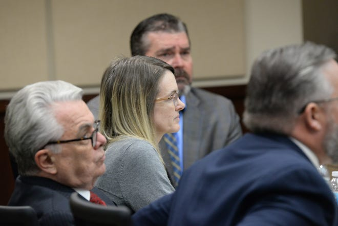 Denise Williams sits with her attorneys as the defense rests their case during Williams' trial for the murder of her husband Mike Williams at the Leon County Courthouse Thursday, Dec. 13, 2018.