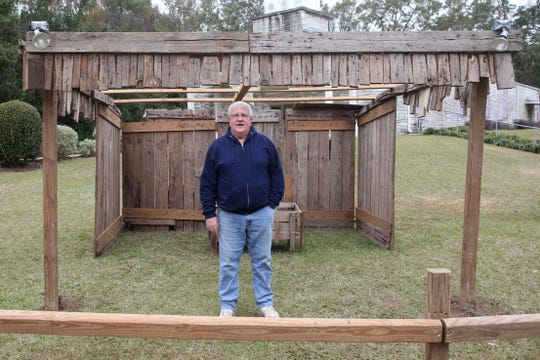 Pastor Jack King of Freedom Road Christian Ministry stands in front of the stable he has built for the past forty years for the Live Nativity, Thursday, Dec. 13, 2018. The Live Nativity is setup outside of Four Oaks Community Church on Eighth Avenue.