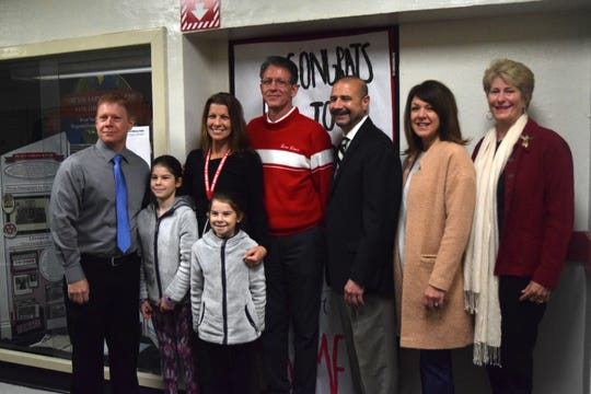 Leon County Schools Teacher of the Year Jeannine Meis (middle left) stands with her family, Leon High School Principal Billy Epting, Superintendent Rocky Hanna and School Board Members Alva Striplin and Rosanne Wood. Meis was surprised with the award during her classes Thursday morning.