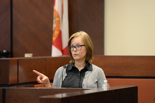 Kathy Thomas, ex-wife of Brian Winchester, identifies Denise Williams in the courtroom as she testifies in the trial of Williams for the murder of her husband Mike Williams at the Leon County Courthouse Thursday, Dec. 13, 2018.