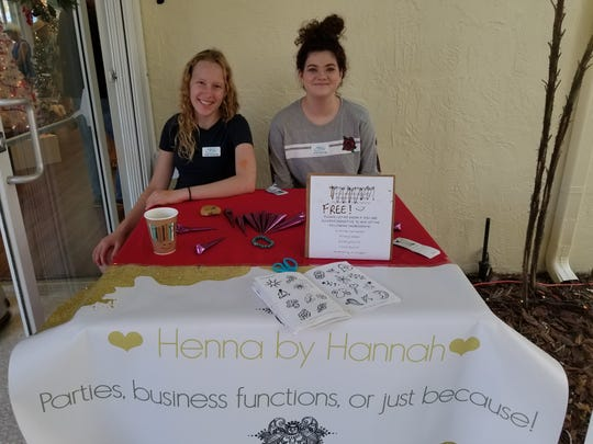 Hannah Greenlee and Alyssa Espitia volunteered their services doing Henna body art at the Festival of Trees & Lights.
