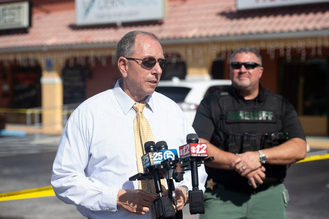 "The Martin County Sheriff's Office, Stuart Police Department and SWAT responded to the scene of a robbery Thursday, Dec. 13, 2018, at the Treasure Coast Liquidators jewelry store in the Granada Plaza in Jensen Beach. Martin County Sheriff William Snyder shared details of the crime, car crash and subsequent manhunt in a news conference following the capture of one of the suspects and hospitalization of the second suspect, who was in ""extremely grave and life threatening"" condition Thursday afternoon, according to Snyder."